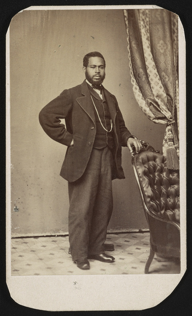 "[African American man, possibly named ""Small"", full length studio portrait, well-dressed, standing, facing front with left hand resting on the back of a chair] / photographed by B.F. Reimer, No. 624 Arch Street, Philada."