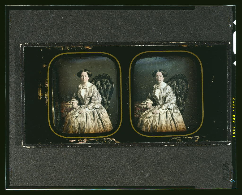 [Henrietta, wife of Wardale G. McAllister, three-quarters length, seated in ornate chair, with arm resting on table with tablecloth]