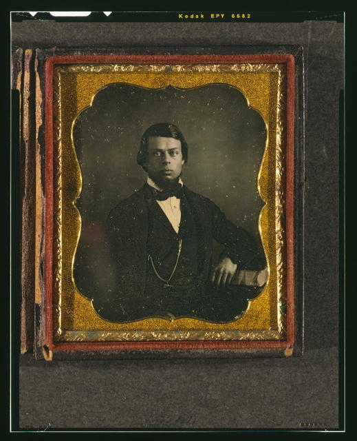 [Unidentified man with chin whiskers, half-length portrait, facing front, with arm resting on book]