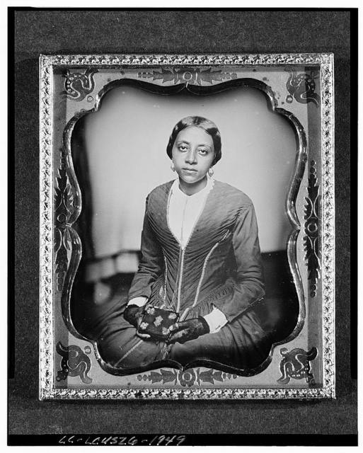 [Unidentified woman, probably a member of the Urias McGill family, three-quarter length portrait, facing front, holding daguerreotype case]