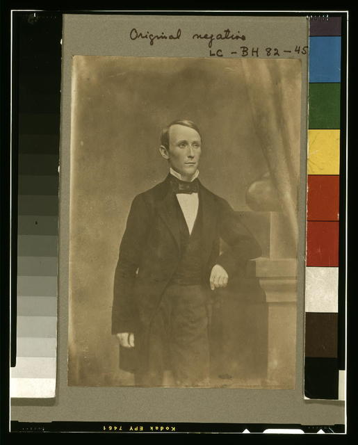 [William Walker, three-quarter length studio portrait, standing, left arm resting on pedestal, facing slightly right]