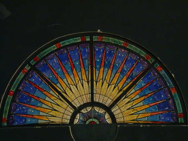 [Design drawing for stained glass Lunette window with radiating yellow light on blue ground]