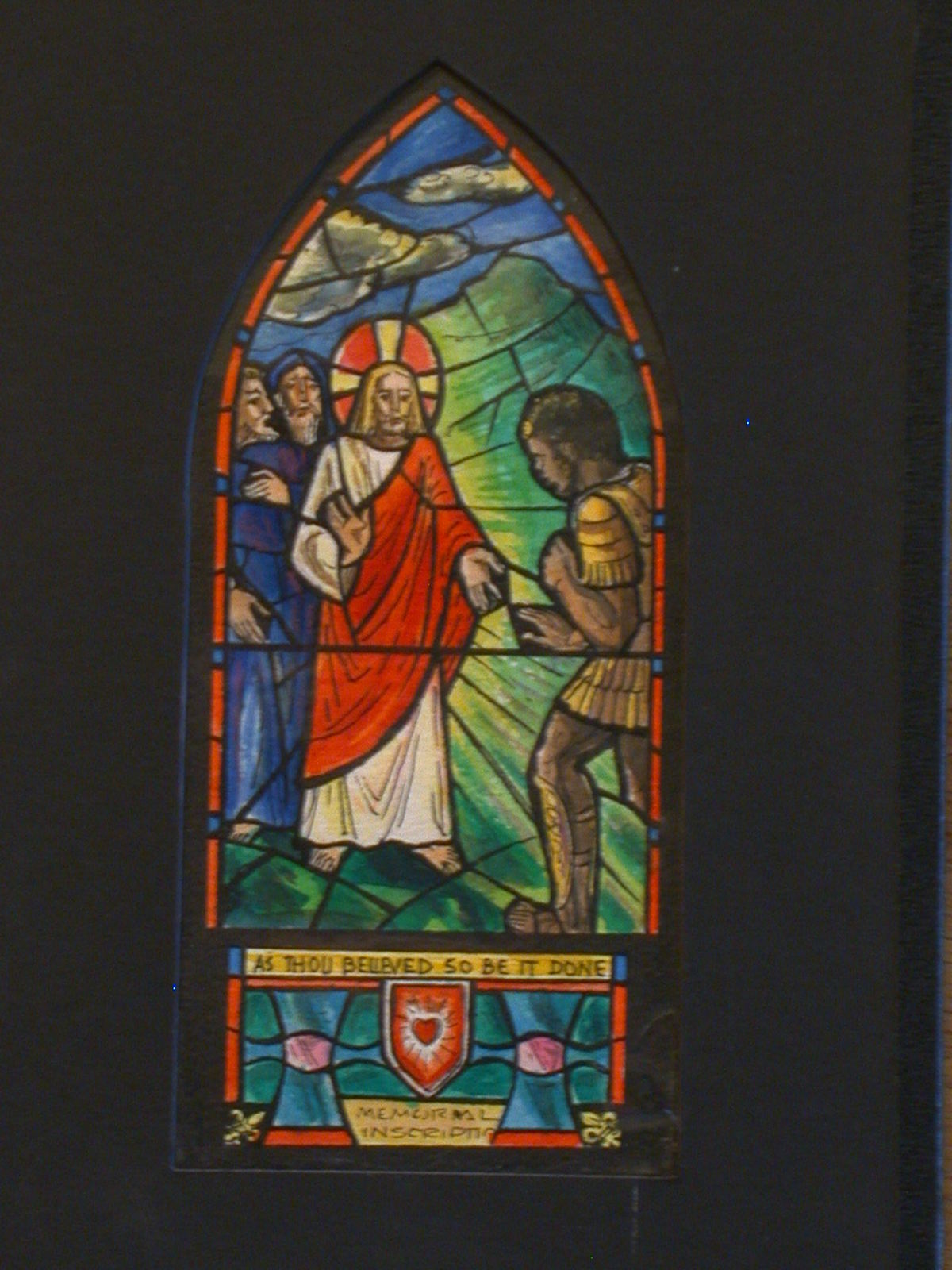 """[Design drawing for stained glass memorial window with text """"As Thou Believed So Be It Done"""" showing a blond Christ healing African centurion]"""
