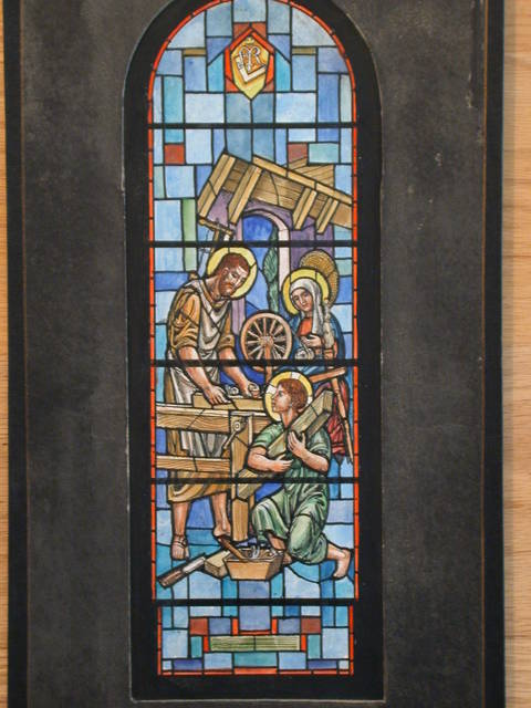 "[Design drawing for stained glass window ""House of Nazareth"" showing Young Christ assisting at carpentry while Mary spins]"