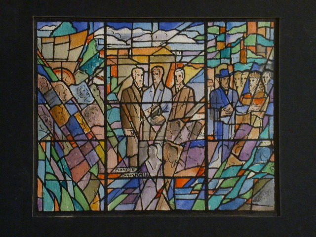 """[Design drawing for stained glass window in highly abstracted style showing elements of Pennsylvania and Kentucky frontier life, including 19th century figures, famous historical Christian Unity advocates, Conestoga wagon, forest, and bonnets; with text """"Pioneer Beginnings"""" ]"""