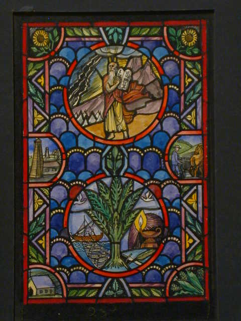 "[Design drawing for stained glass window ""Rogationtide ... springtime counterpart of the other window's main theme Thanksgiving ... with beginnings"" showing farmer, oil well, ship/fishermen, Neo-Gothic church, 10 Commandments, lamp, sword, sunflowers ""the state flower of Kansas,"" and ""steep hills...like...around here!""]"