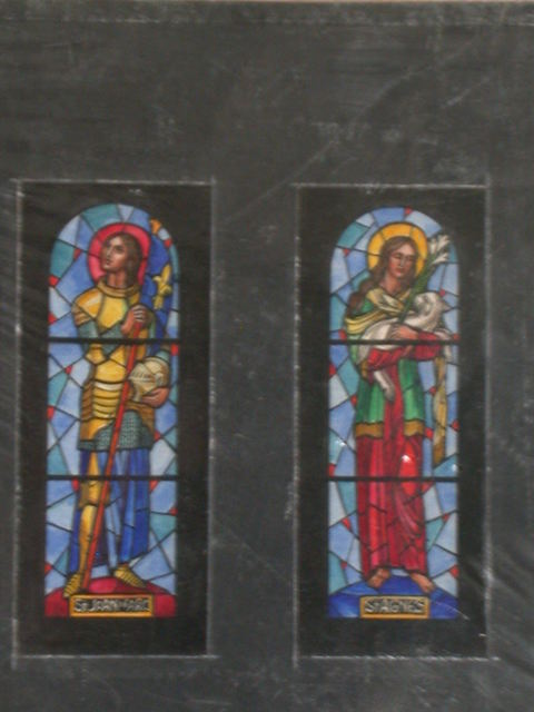 [Design drawing for stained glass window showing St. Joan of Arc in armor; and St. Agnes with lamb, and lilies]