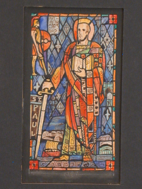 """[Design drawing for stained glass window showing St. Paul holding sword and Bible, with temple, sailboat, triumphal arch, city and legionnaire; with text """"Put on the Armor of God""""]"""