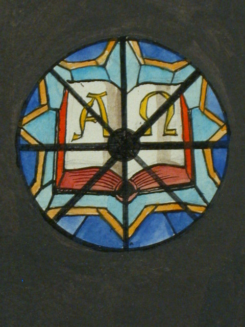 [Design drawing for stained glass window with Alpha and Omega in open book]