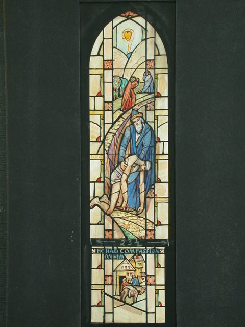 "[Design drawing for stained glass window with text ""He had compassion on Him"" and Good Samaritan with crook and heart symbol and architecture]"