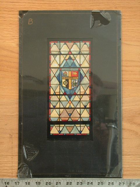 """[Design drawing for stained glass window with """"The Reformed Church in the USA"""" and logo shield on colored diamond pane pattern]"""
