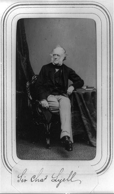 [Sir Charles Lyell, full-length portrait, seated at small table, facing left]