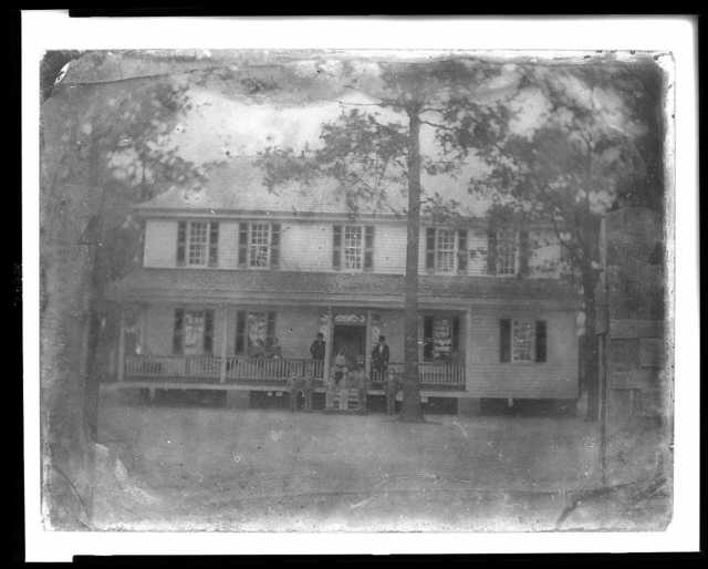 [Stirrup Branch Plantation, Bishopville, S.C., on the 75th birthday of Capt. James Rembert, June 8, 1857 - front view of house shows Capt. Rembert and family]