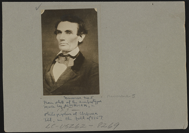 [Abraham Lincoln posed in a borrowed coat, in Urbana, Illinois]