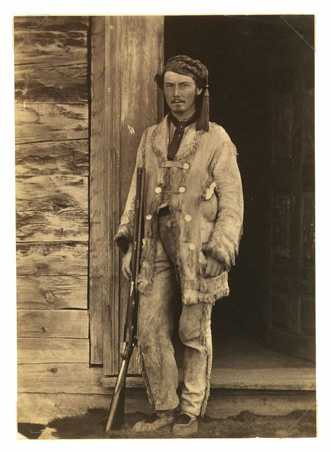 [Charles W. Wilson, full-length portrait, standing, facing front, wearing buckskins, with rifle]