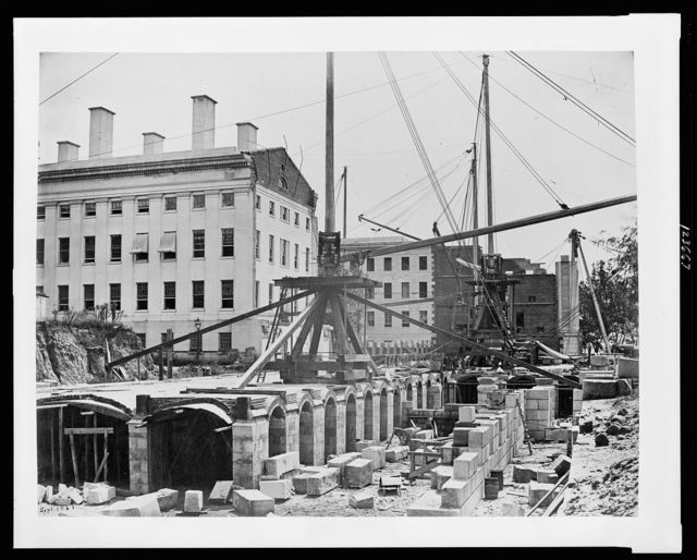 [Construction of the United States Treasury Building, Washington, D.C., showing construction equipment and building materials]