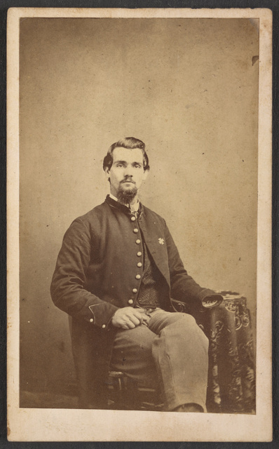 [Private Vernon Mosher of Co. F, 97th New York Infantry Regiment, in uniform, amputated hand visible] / Thos. D. Givin, photographer, No. 432 Chestnut Street, Philadelphia.