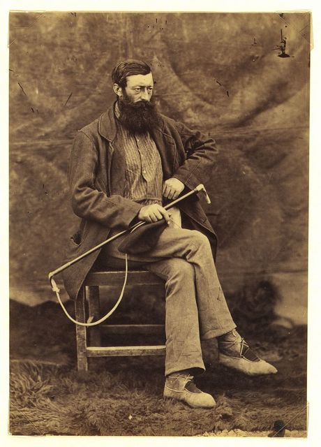 [Unidentified man, possibly John Keast Lord, naturalist with the Commission survey, full-length portrait, seated, facing right, holding dog whip]