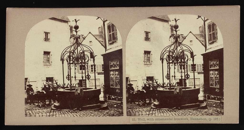 Wells, with ornamental ironwork, Hennebon (p. 187.)