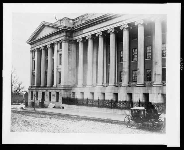 [Facade of the United States Treasury Building, Washington, D.C., with a carriage on street near building]