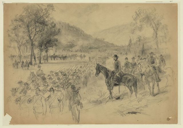 [A general and his staff reviewing troops in the field]