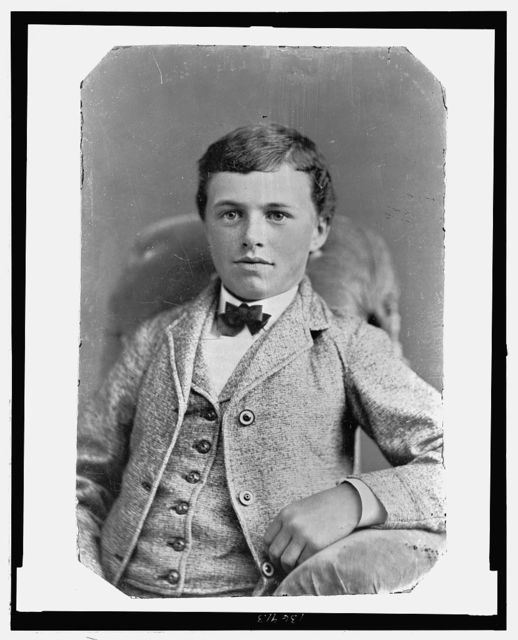 [Boy, seated, frontal]