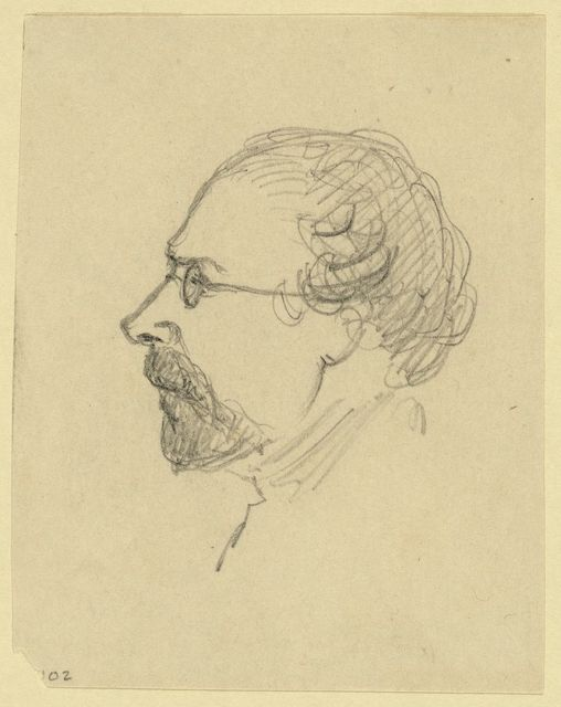 [Bust-length profile portrait of a man wearing glasses]