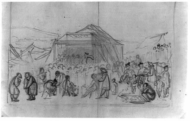 [Chinese market day bazaar, with a performance taking place on a stage in the background]