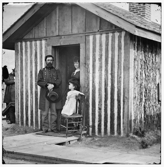 [City Point, Va. Brig. Gen. John A. Rawlins, Chief of Staff, with wife and child at door of their quarters]