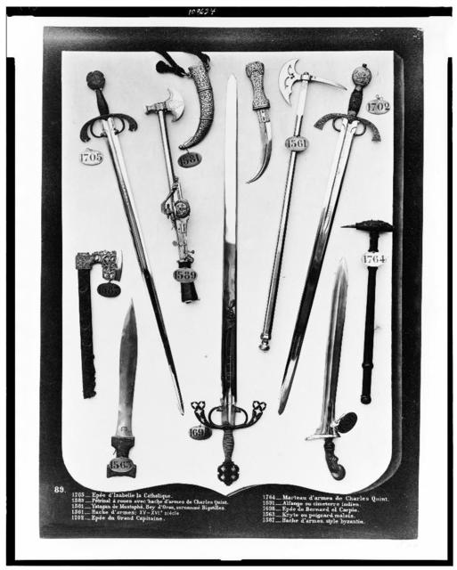 [Daggers, swords, and battle hatchets displayed at the Armory, Madrid, Spain]