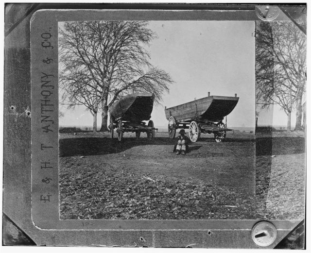 [Dutch Gap, Virginia (vicinity). Pontoon boats on wheeled carriages at deserted farm house near Dutch Gap canal]