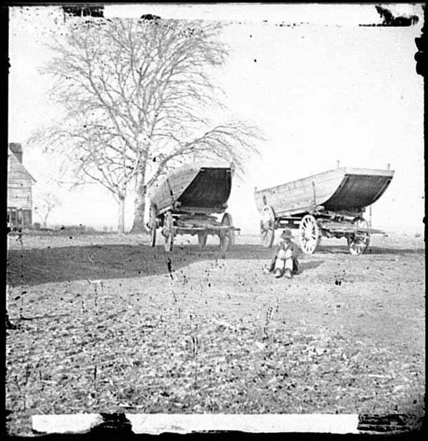 [Dutch Gap, Virginia (vicinity). Pontoon boats on wheeled carriages at deserted farm house near Dutch Gap canal]
