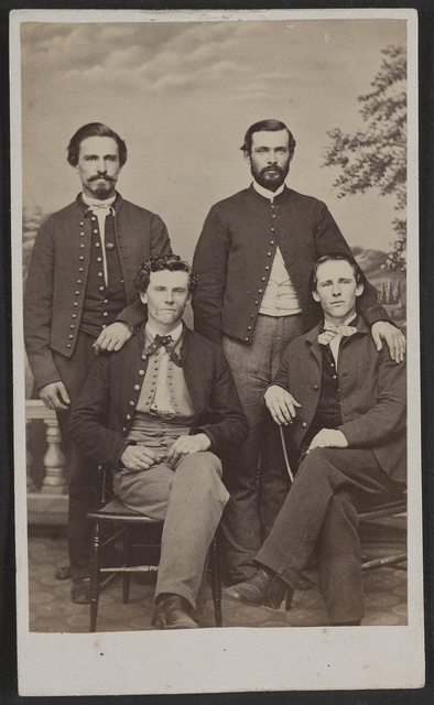 [Four unidentified men in front of painted backdrop] / Hollyland's [sic] Metropolitan Photograph Gallery, 250 Pennsylvania Avenue, Washington, D.C.