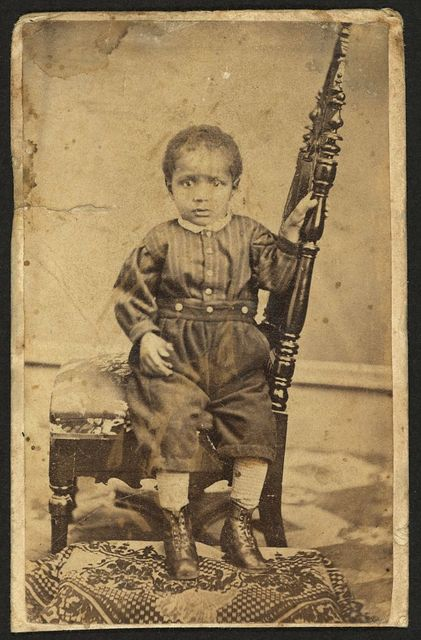 [Full-length portrait of an African American toddler seated on a chair] / M. L. Albright, Photographist, Urbana, Ohio.