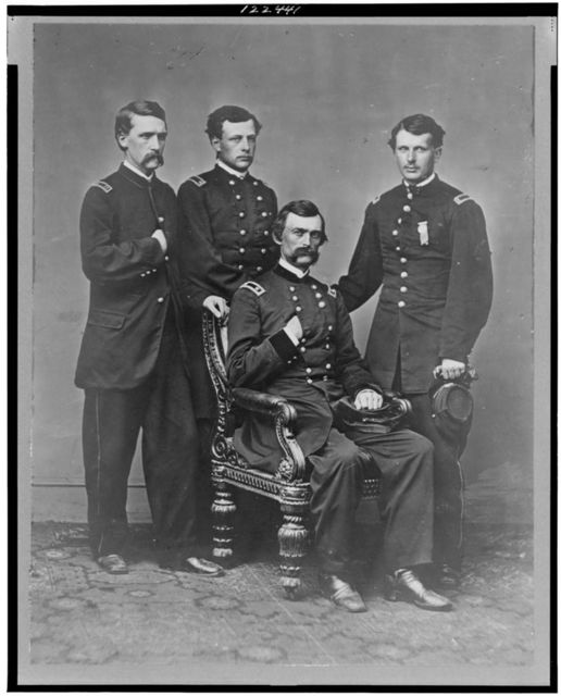 [General Charles Griffin, full-length portrait, seated, with three aides standing behind him]