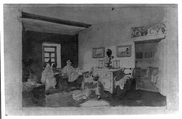 [Interior of a western style house, possibly at a border post, with Russian empire chair and western picture frames]