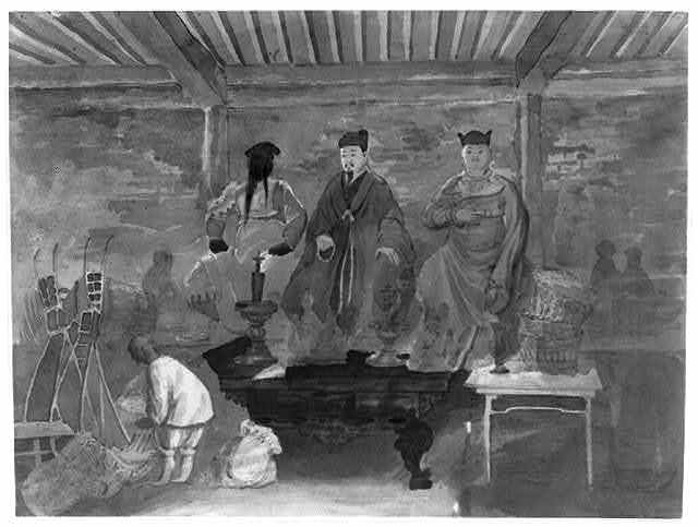 [Interior of Buddhist temple or shrine with statues of (from left) Guan Yu, Liu Bei, and Zhang Fei]
