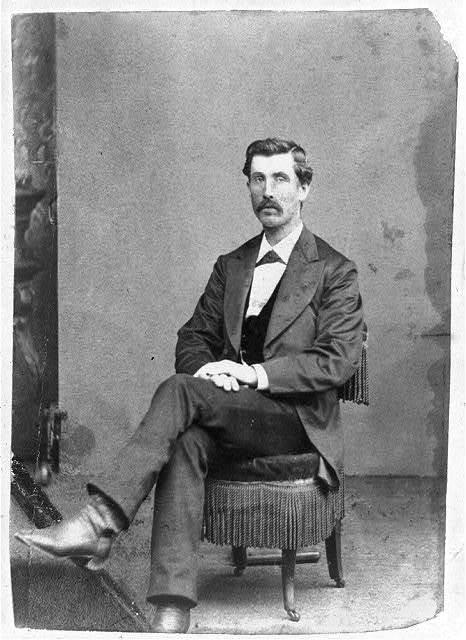 [Jeff Whitman, full-length portrait, seated, facing left]