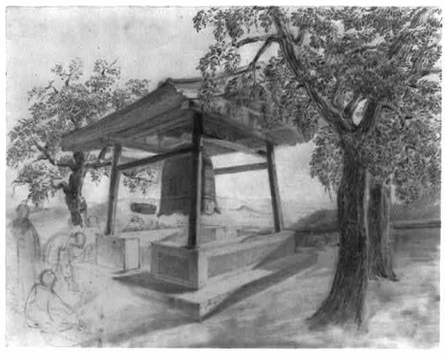 [Large bronze bell with external clapper in belfry among trees at Buddhist temple, with monks on the left]