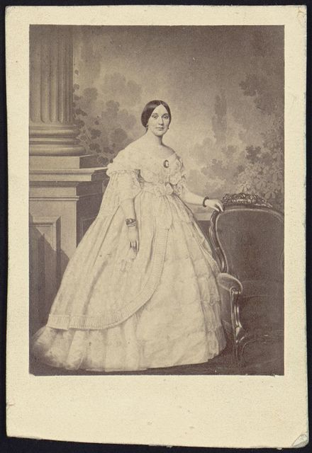 [Mrs. Jefferson Davis, full-length studio portrait, standing, facing slightly right with left hand resting on the back of a chair]