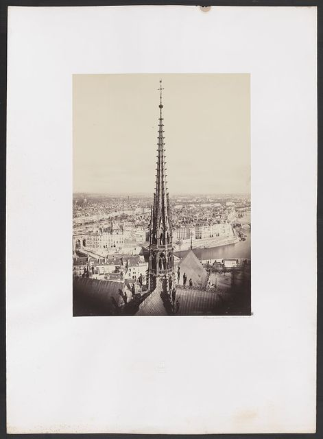 [Notre Dame, Paris, France. View of spire, roof with statuary, and cityscape beyond] / Ch. Marville.