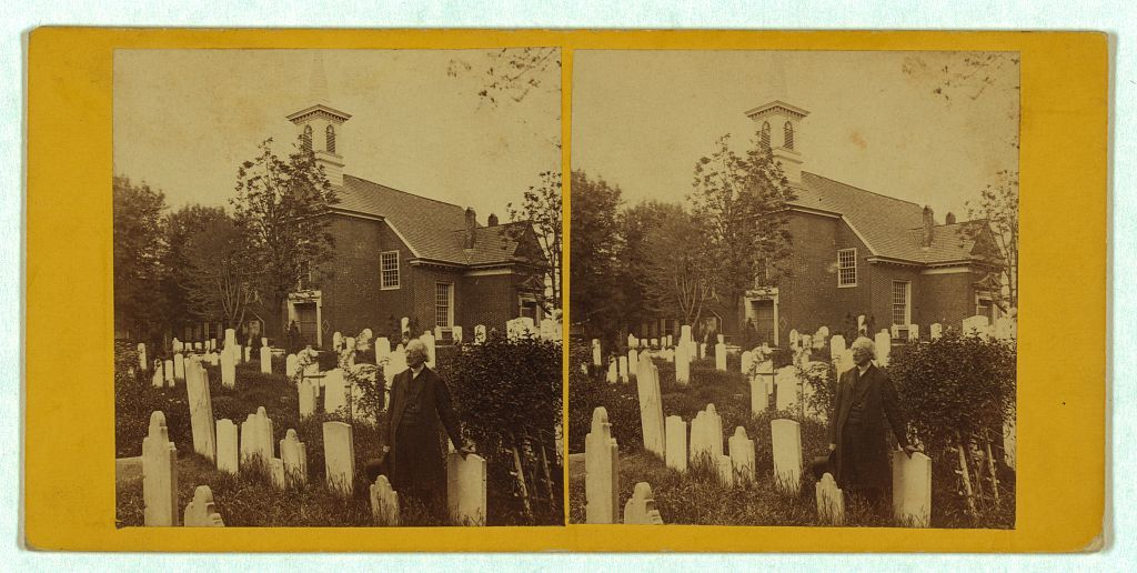 [Old Swedes Church (Gloria Dei Church) and cemetery, Philadelphia, with Reverend Jehu Curtis Clay standing among gravestones]