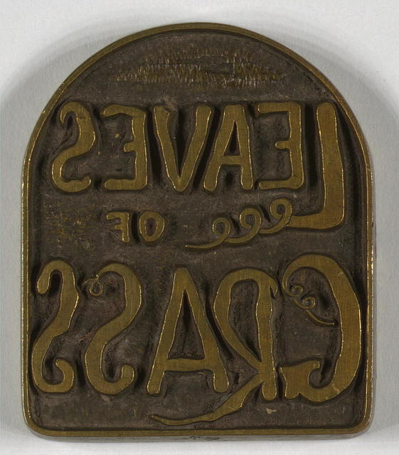 Original brass dies used for 1860 edition of leaves of grass. Leaves of grass [on tombstone-shaped brass plate]