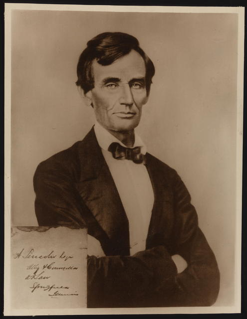 [Reproduction print of Lincoln with signature insert at lower left.]
