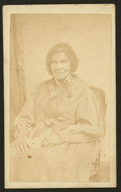 [Three-quarter-length portrait of an African American woman seated, facing front] / S. J. Thompson, Photographer, 55 State St., ... Albany, N.Y.