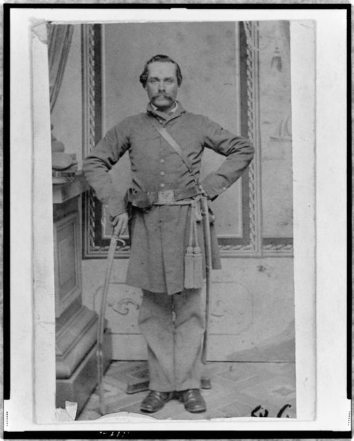 [Unidentified Confederate(?) officer, full-length portrait, standing, with sword in right hand]