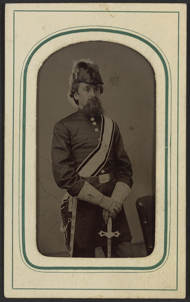 Unidentified man in Masonic regalia including gauntlets, belt, sash