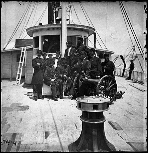 [Unknown location. Officers of the U.S.S. Philadelphia before pilot-house]