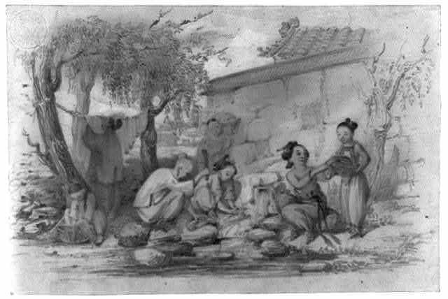 [Women and girls, outside a building, washing clothes in a stream by pounding and rinsing, and hanging on a rope strung between two trees]