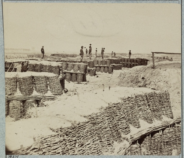[A group of soldiers stand on gabions used as fortifications near Petersburg, Virginia]